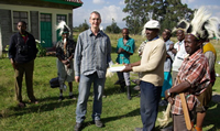 David Fox handing over NGO books for conservation
