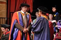 Receiving his honorary doctorate
