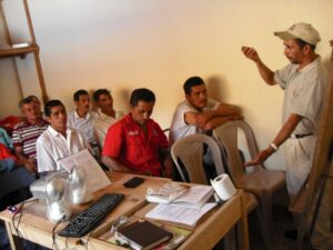 Carlos leads a workshop with a group of farmers
