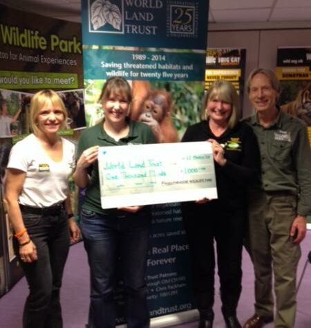 Representatives of Paradise Wildlife Park present Kelly Jacobs with a cheque for £1,000.