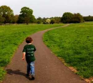 Dillon Burgess walking through Millennium Green.