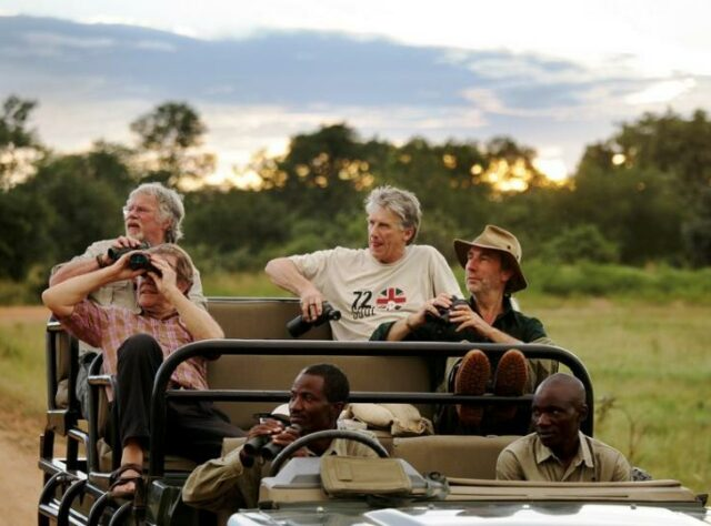 Bill Oddie in a jeep in Zambia