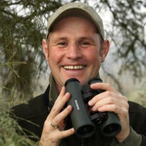 Mike Dilger with binoculars