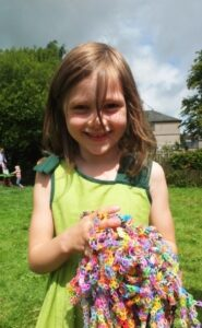 Holly holds a bundle of loom bands.