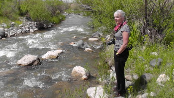 Nicola Davies by a stream in Armenia.