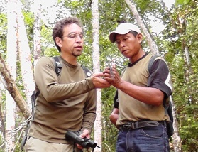 Ricardo Coc and Marco Cerezo examine a wildlife specimen.