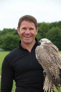 Steve Backshall with a raptor.