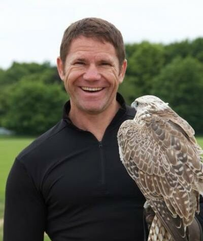 Steve Backshall with a raptor.