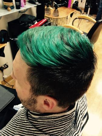 A view of Steve's hair dyed forest green.