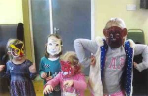 Children from St John's wearing animal masks.