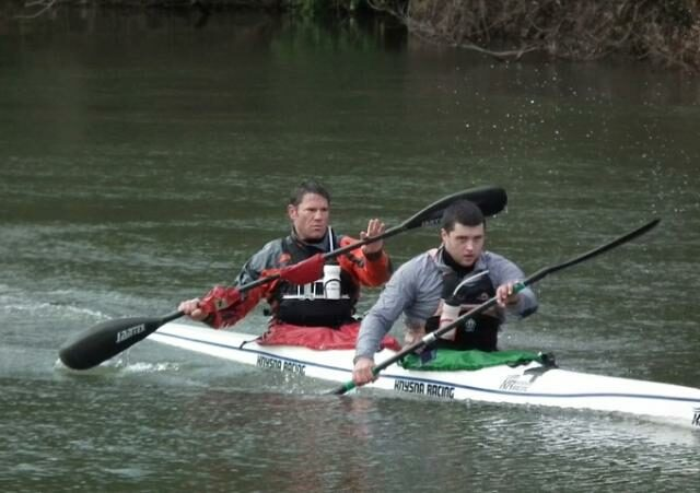 Steve Backshall and George Barnicoat in a kayak.