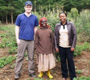 Chris Smith and Joan Gichuki with a local farmer at Mount Kenya.