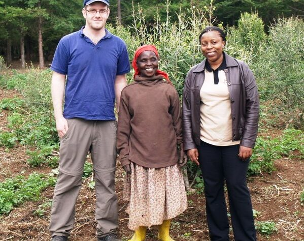 Chris Smith and Joan Gichuki with a local farmer at Mount Kenya.
