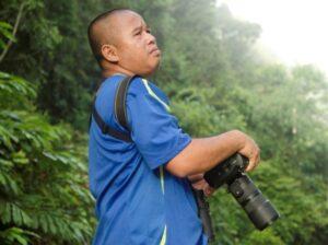 Ranger Berjaya searching for wildlife in the Deramakot Forest Reserve.