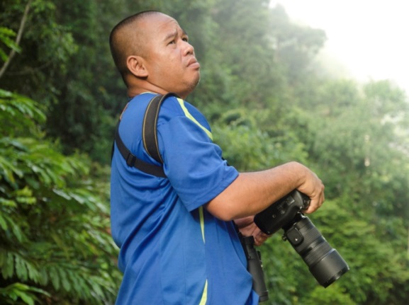 Ranger Berjaya searching for wildlife in the Deramakot Forest Reserve.