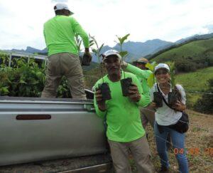 Ranger Antonio planting trees.