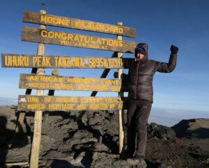 Helen Cox at the summit of Kilimanjaro.