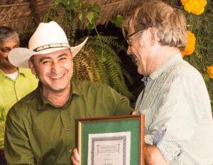 Ruben presents John with award