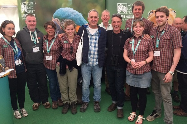 WLT staff with Nick Baker and Mark Carwardine at the WLT Birdfair stand