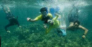Marine camp schoolchildren and volunteers underwater at Danjugan island. Credit Toby Gibson