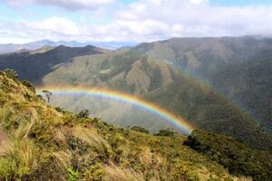 A double rainbow falls over the Montane Forest and Paramo of the San Juan de Sallique ACP