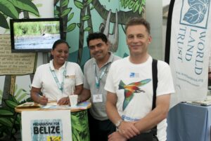 World Land Trust's stand at Birdfair 2015. Chris Packham with Vladimir Rodriguez and Therese Jonch from Programme for Belize.
