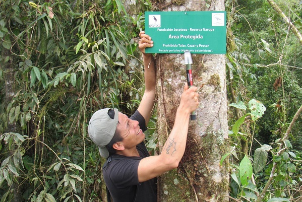 Wildlife ranger putting up protected area sign