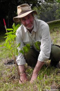 Simon Barnes plants a tree with Hutan, WLT's partner in Malaysian Borneo.