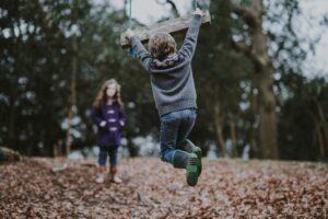 Children Playing with a Swing. Credit: Annie Spratt on Unsplash