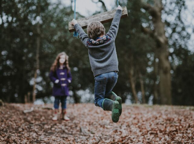Children Playing with a Swing. Credit: Annie Spratt on Unsplash