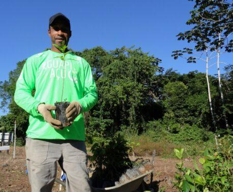 Mauricio Noqueira holding a sapling at REGUA, Brazil.