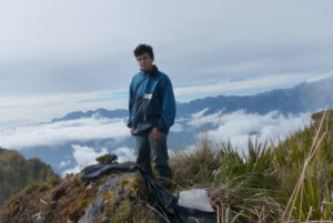 Darwin Recalde standing on a mountain in the Andes