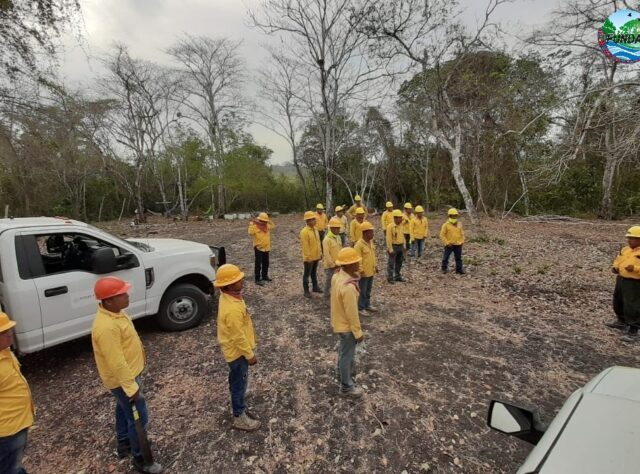 Image of a fire fighting team in Guatemala, gathering for a socially distanced briefing.